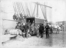 [Men unloading ship at Stimson's wharf]