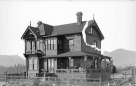 [Family assembled on porch of John Moore Bowell residence at 1207 Haro Street]