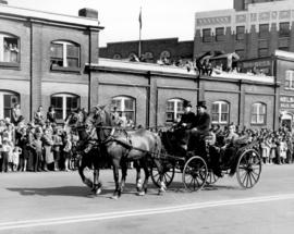 [A horse-drawn carriage in the Diamond Jubilee Parade]