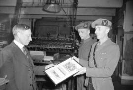 [Man receiving certificate for volunteer service with Canada's fighting forces]