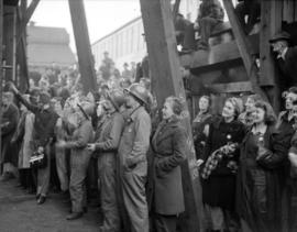 [Crowd and shipbuilders at a boat launching]