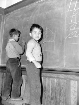 Boys at blackboard [in] Nanaimo Indian School