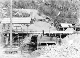 [Scaffolding, shelters and debris at excavation site for Buntzen Lake Power Plant number one]