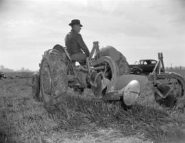 [Man seated on a tractor]