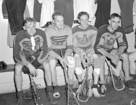 Lacrosse players seated on a bench