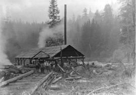 [A team of horses hauling logs at the Buntzen Lake Dam construction site]