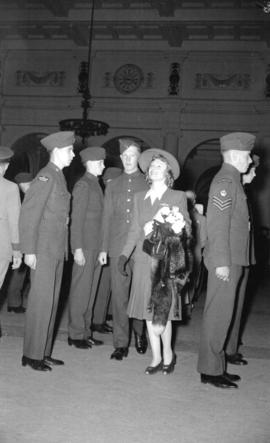 [Anna Neagle reviewing air Force men]