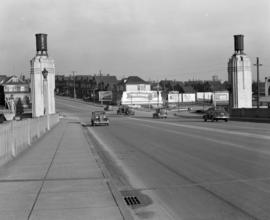 [View of the north end of the Burrard Street Bridge showing billboards and houses along Pacific a...