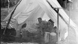 [John Davidson and unidentified man in a tent]