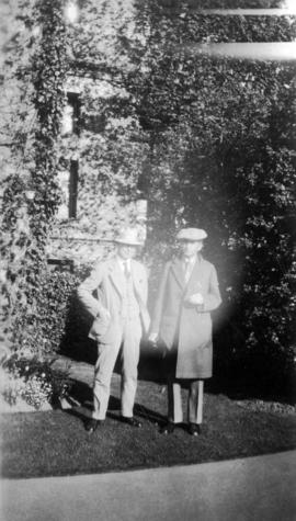 [L.D. Taylor and unidentified man standing in front of a building]