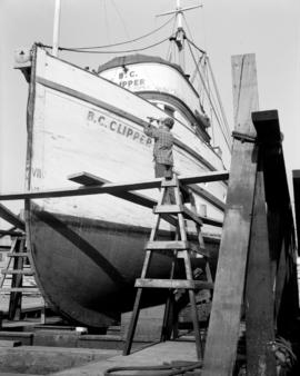 "[Man working on the ""B.C. Clipper"" in dry dock]"