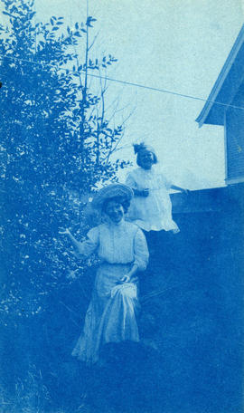 [Unidentified woman and girl next to tree]