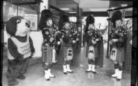 Tillicum and four bagpipers