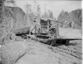[Moving logs with a tractor for] Pacific Mills [on the] Queen Charlotte Islands