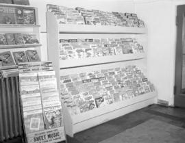 [Magazine rack and sheet music display]