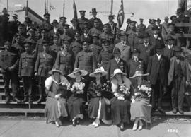 War dance and carnival [group of military and civilian men and women]