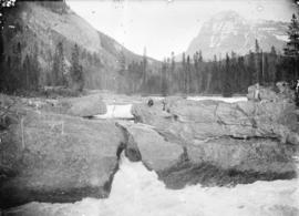 Natural bridge on Kicking Horse River and Mt. Stephen. C.P.R. Field