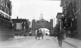 [Looking south on Granville Street at Dunsmuir Street at the Progress Club Arch for the visit of ...