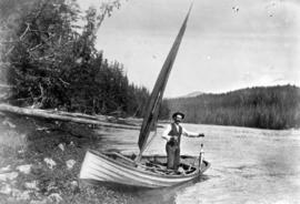 [Unidentified man in boat with fish]