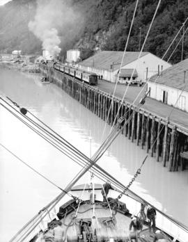 [View of Canadian National Railway terminal and wharf from ship, Skagway Alaska]