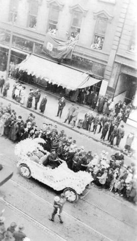 [View of decorated Hudson Bay Co. car in a parade on Hastings Street]