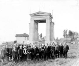 [Group gathered in front of the Peace Arch]