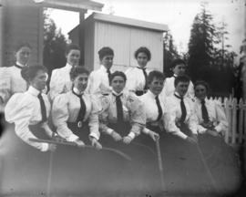 [Women's field hockey team assembled in front of fence at Brockton Point grounds]