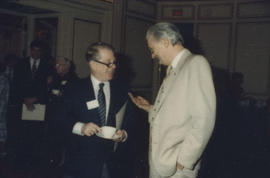 Two unidentified men talking in Grand Ballroom