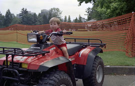 Boy sitting on four wheeler