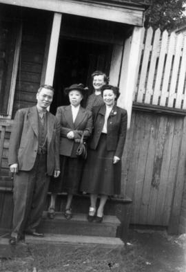 Lillian Ho Wong, Winnifred Eng, and unidentified man and woman at the alley entrance to 350  East...