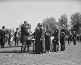 King's Jubilee Parade [Man and woman shaking hands at medal ceremony]