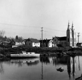 Boat at Mosquito Creek with St. Paul's Church in background