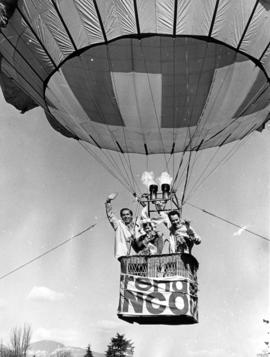 Mayor Tom Campbell, Daffodil Queen Lynn McCulloch, and Stan Sheldrake in a balloon over Stanley Park