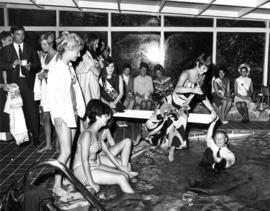 Miss P.N.E. 1968 contestants around pool at Miss P.N.E. Welcome Banquet
