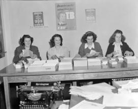 [B.C. Tuberculosis Society volunteers stuffing envelopes for a  mailing campaign]