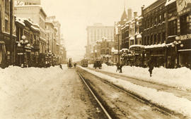 [Looking north from Georgia Street at a snow-covered Granville Street]