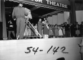 Nancy Hansen being interviewed on Outdoor Theatre stage after being named Miss P.N.E. 1954