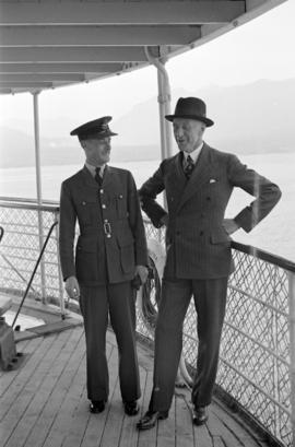[Harold Brown, General Manager of Union Steamship Company with an air force officer aboard  the U...