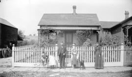 [Daniel McPhalen and family standing outside residence at 209 Harris Street (Georgia Street)