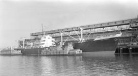 S.S. Valldemosa [at dock, with barges alongside]