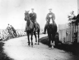 [John Williams and D.C. McGregor riding horses at Brockton Point]