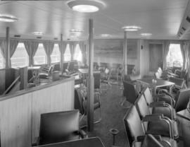 [Interior view of a seating area on a ship]