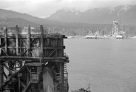[The Lions Gate Bridge under construction]