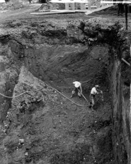 Excavation for footing of a pier [men working in excavation pit]