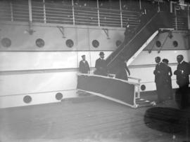 "[Duke and Duchess of Cornwall and York walking down gangplank of ""Empress of India"" on ..."