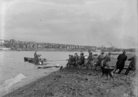 Vancouver Volunteer Regiment Artillery [hauling gun up beach]