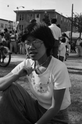 Woman sitting on grass at the 1977 Powell Street Festival