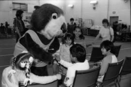 Tillicum interacting with children