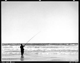 Man and ocean [man fishing in the ocean]