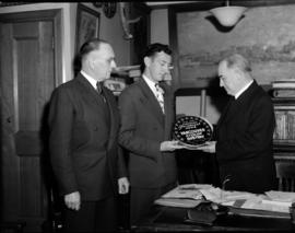 "[Major Matthews being presented with a copy of the Canadian Paramount News, ""Vancouver, City..."